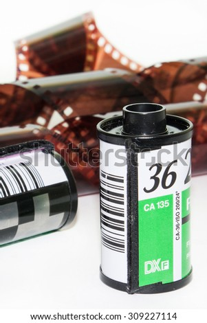 Analog film roll with new film on the white background. - stock photo