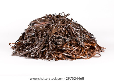 Analog Magnetic Tape Messy Heap on white background - stock photo