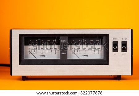 Analog Peak RMS Audio Power VU Meter with needle and LED frontal view - stock photo