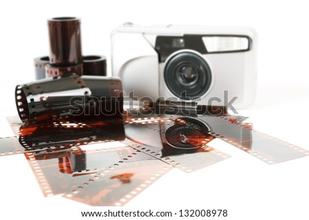 analog photo camera and color negative films on white - stock photo