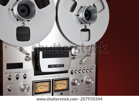 Analog Stereo Open Reel Tape Deck Recorder Vintage Device - stock photo