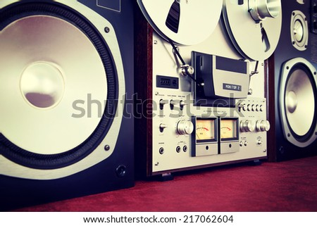 Analog Stereo Open Reel Tape Deck Recorder Vintage with Speakers Closeup - stock photo
