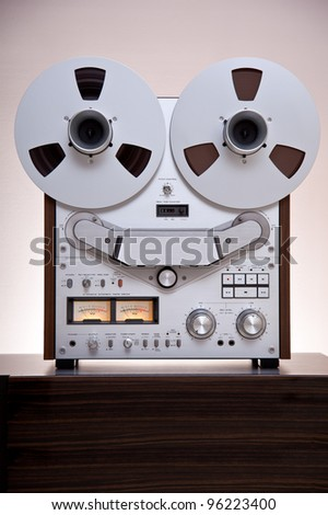 Analog Stereo Open Reel Tape Deck Recorderwith large reels - stock photo