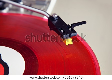Analog Stereo Turntable Red Vinyl Record Player Head Shell Cartridge - stock photo