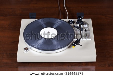 Analog Stereo Turntable Vinyl Record Player  - stock photo
