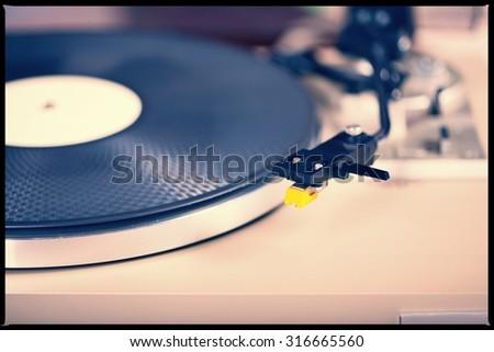 Analog Stereo Turntable Vinyl Record Player Tonearm Cartridge - stock photo