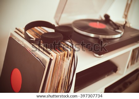 Analog Stereo Turntable Vinyl Record Player. Vinyl collection. Headphones - stock photo