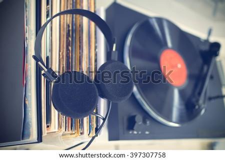 Analog Stereo Turntable Vinyl Record Player. Vinyl collection. Headphones - stock photo