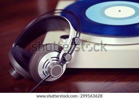 Analog Stereo Turntable Vinyl Record Player with headphones - stock photo