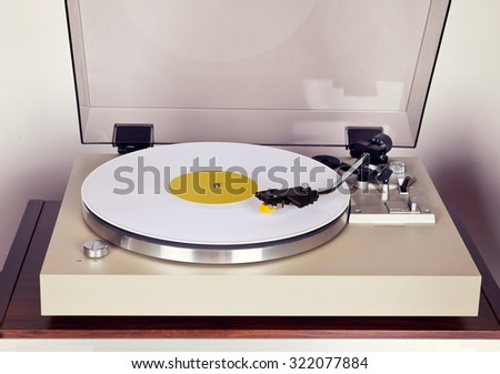 Analog Stereo Turntable Vinyl Record Player with White Disk  - stock photo