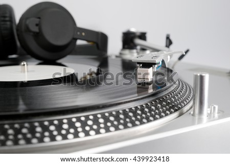 Analog Stereo Turntable White Vinyl Record Player white Head shell Cartridge Black Headphones - stock photo