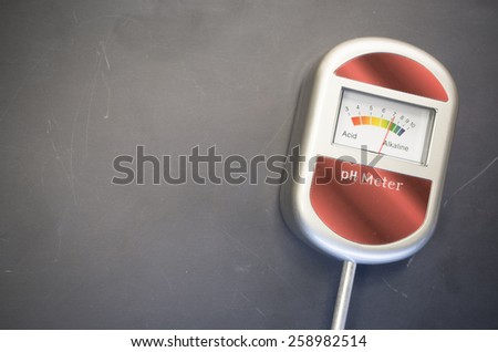 analog tool to measure soil ph on a blackboard background - stock photo