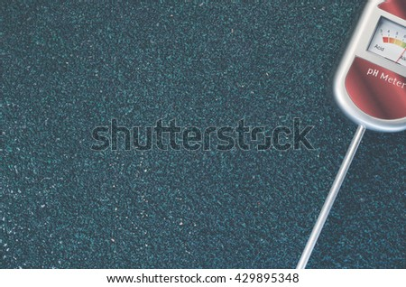 analog tool to measure soil ph on a rough textured background - copy space - stock photo