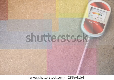 analog tool to measure soil ph on anatural stone background - dodged copy space - stock photo