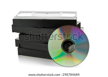 Analog video cassettes with DVD disc - old movies backup or transfer concept - stock photo
