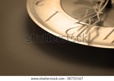 analog watch in midnight close-up sepia toned - stock photo