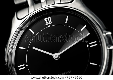 Analog wrist watch closeup with minute pointer in movement, Time flies concept - stock photo