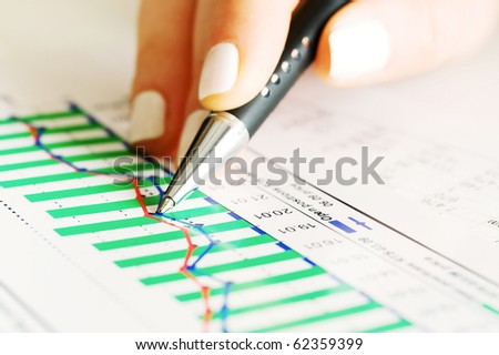 Analysis of business graphs and charts. - stock photo