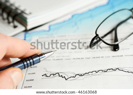 Analysis of business reports. - stock photo