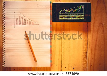 Analysis of stock graph on mobile - stock photo