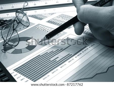 analysis of stock market graphs - stock photo