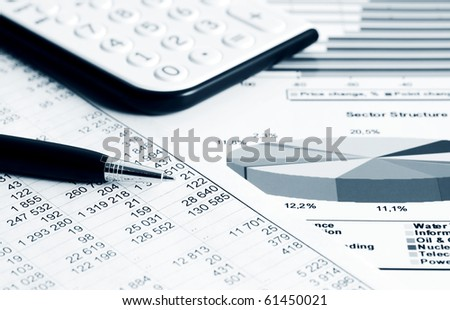 Analysis of stock market graphs and charts. - stock photo