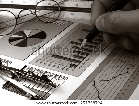 Analysis of stock market graphs monochrome image - stock photo