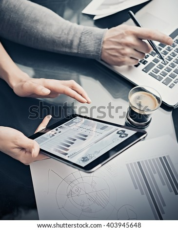 Analytical department working process.Closeup woman showing business reports modern tablet screen.Statistics graphics screen.Banker holding pen for signs documents,discussion startup.Film effect - stock photo