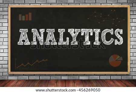 ANALYTICS (Analysis Analytic Marketing  Graph Diagram) on brick wall and chalkboard background