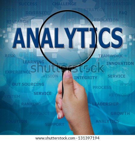 ANALYTICS in Magnifying glass on blue background - stock photo