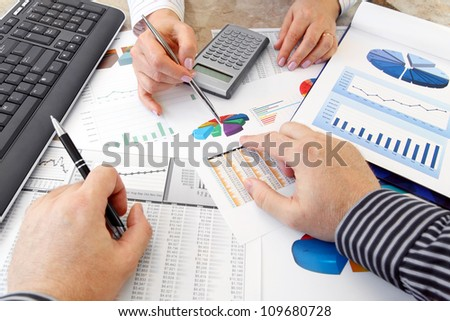 Analyzing Data  Hands with Financial  Charts  at Business Meeting in the Office - stock photo