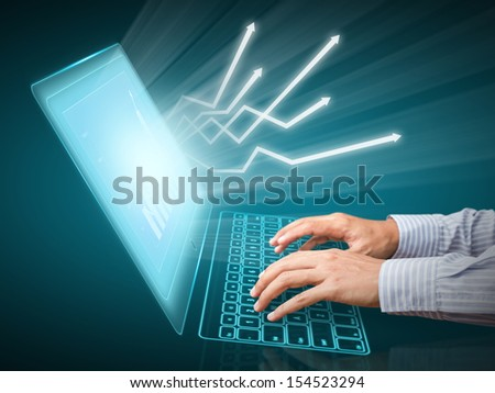 Analyzing financial data and charts on computer screen - stock photo
