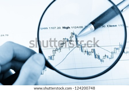 Analyzing the stock market - stock photo