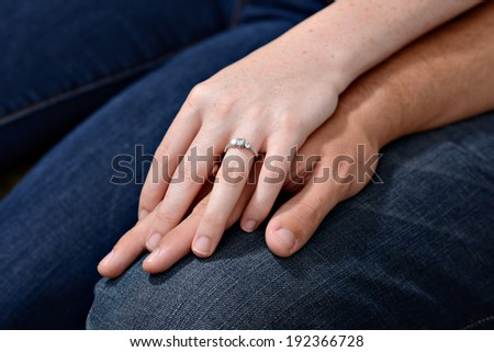 Anamnesia of a young couple embracing their hands - stock photo