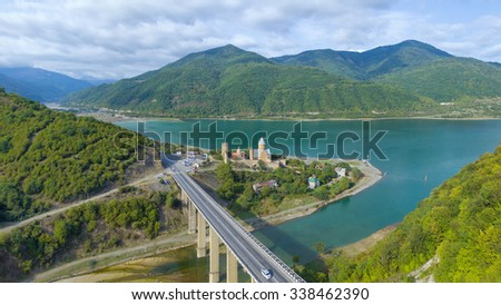 ANANURI, GEORGIA - September 13, 2015: Aerial view of Ananuri fortress and church near Zhinvali water reservoir on river Aragvi, Georgia. Camera flies on a drone. - stock photo