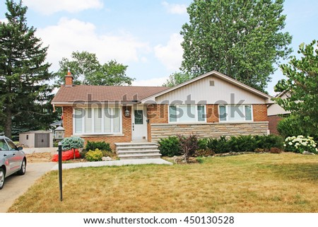 ANCASTER, CANADA - JULY 6, 2016: Suburban house. Ancaster is a picturesque and historic community located on the Niagara Escapement, within the greater area of the city of Hamilton, Ontario, Canada.