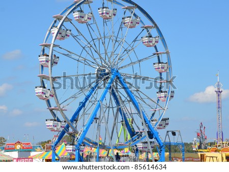 ANCASTER, ONTARIO, CANADA - SEPTEMBER 24: Ferris wheel and overview of the Midway at the yearly Ancaster Fair on September 24, 2011 in Ancaster, Ontario, Canada