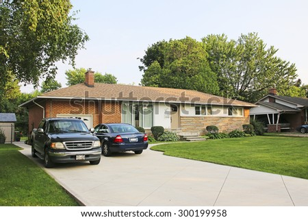 ANCASTER, ONTARIO - JULY 12, 2015: Suburban house, Ancaster, Ontario. Ancaster is a community located on the Niagara Escarpment that amalgamated with the city of Hamilton, Ontario, Canada in 2001 - stock photo