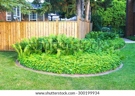 ANCASTER, ONTARIO - JULY 12, 2015: Suburban lawn, Ancaster, Ontario. Ancaster is a community located on the Niagara Escarpment that amalgamated with the city of Hamilton, Ontario, Canada in 2001 - stock photo