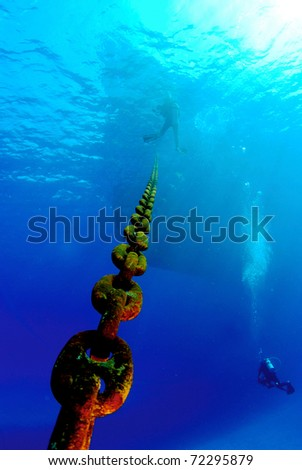 Anchor Chain with bow and diver - stock photo