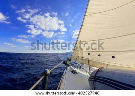 Anchor, forestay and furling drum on the yacht bow in sea