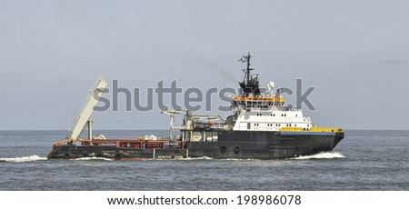 Anchor handling supply tug - stock photo
