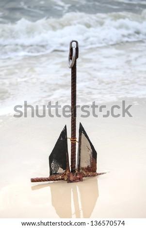 Anchor on the beach - stock photo