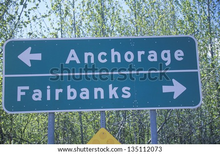 Anchorage and Fairbanks sign with trees in the background
