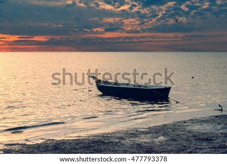 Anchored boat on a beach of the Baltic Sea, Latvia
