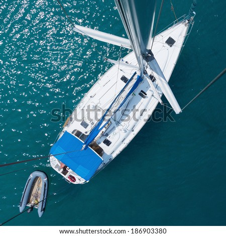 Anchored sail boat, view from top of the mast - stock photo