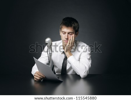 Anchorman bored reads the news - stock photo