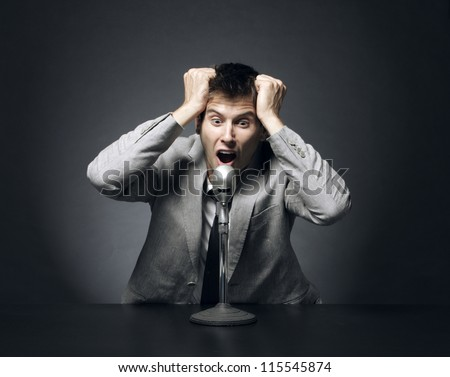 Anchorman desperate shouts and gesticulates news - stock photo