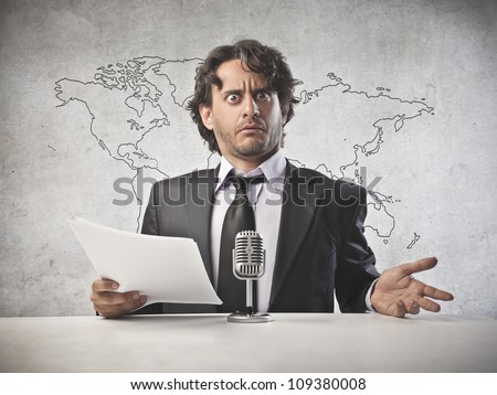 Anchorman reading the news into the microphone [Elements of this image furnished by NASA] - stock photo