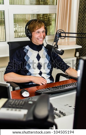 Anchorman sitting in front of a microphone on the radio - stock photo